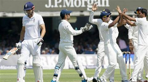 India's players celebrate taking the wicket of England's captain Alastair Cook, left, during the second day of the second test match between England and India at Lord's cricket ground in London. (AP Photo)