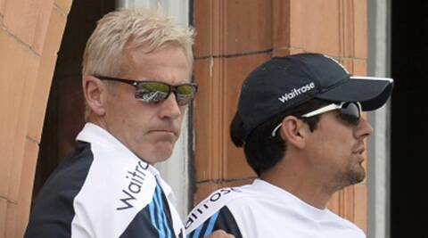 Alastair Cook sits with coach Peter Moores (L) on the dressing room balcony during the second Test against India. (Source: Reuters)