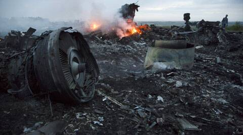 Debris at the crash site of a passenger plane near the village of Hrabove, Ukraine. (Source: AP)