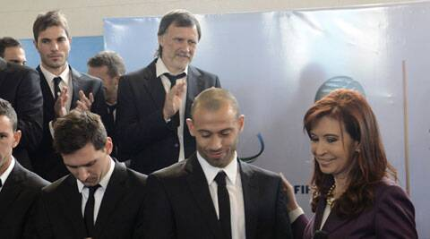Argentina's President Cristina Fernandez with Lionel Messi and Javier Mascherano. )(Source: Reuters)
