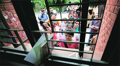 Students queue up at an admission counter at Miranda House on Tuesday. (Source: Express photo by Ravi Kanojia)