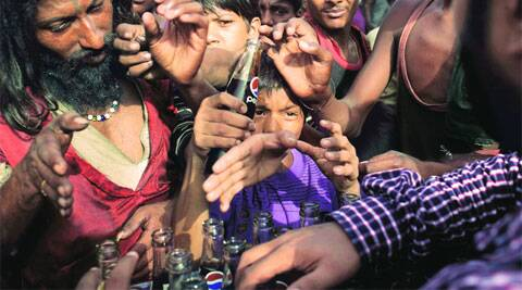 People reach out for drinks being served as part of charity on a hot summer afternoon in New Delhi on Thursday.