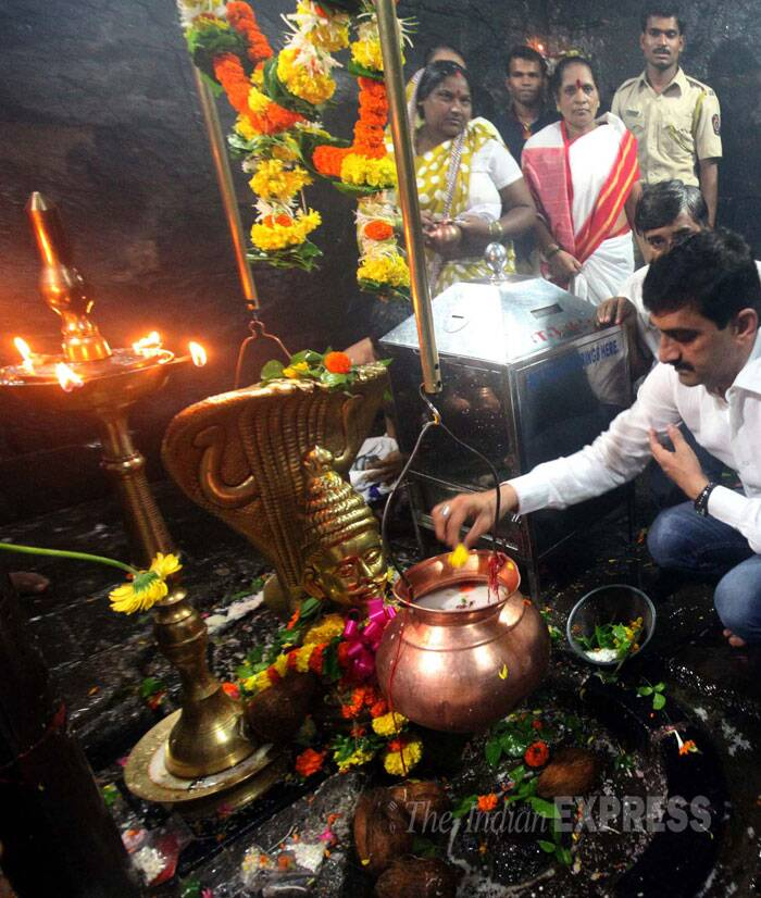 A devotee offering prayers at the ancient Ambreshwar Shiva Temple in Ambernath. (Source: Express photo by Deepak Joshi)