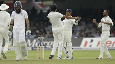 Dhoni celebrates Moeen Ali's wicket with Ishant Sharma, who took a career best seven-wicket haul to bowl India to victory against England. (Source: AP)