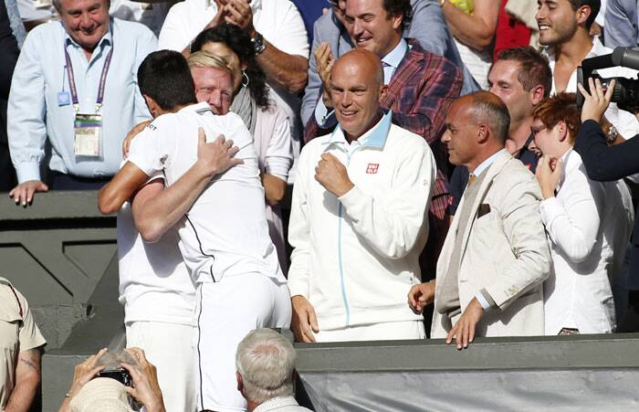 After the grass meal, he ran up to his players box to celebrate with the near and dears. Seen here: with his coach Boris Becker (Source: AP)