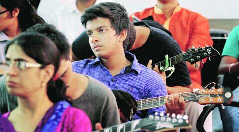 Students wait for music trials at Kirorimal College on Thursday. ( Express photo by: Ravi Kanojia )