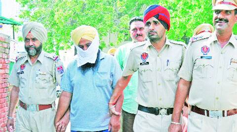 Jasveer Singh in police custody on Saturday. ( Express photo by Jasbir Malhi )