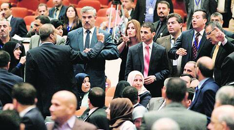 Members of the newly elected Iraqi parliament point fingers during an argument at the parliament in Baghdad Tuesday. ( Source: Reuters )