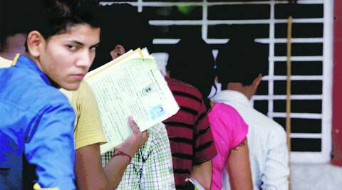 Students wait for admission at Ramjas College, North Campus. (Source: Express photo by Amit Mehra)