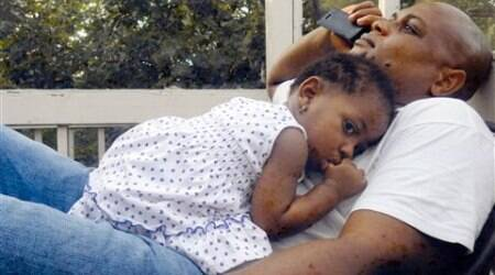 Patrick Sawyer is shown with his daughter Ava at their home in Coon Rapids. Sawyer died from Ebola after traveling from his native Liberia to Nigeria. (Source: AP)