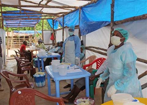 Medical personnel inside a clinic taking care of Ebola patients in the Kenema District on the outskirts of Kenema, Sierra Leone. (Source: AP)