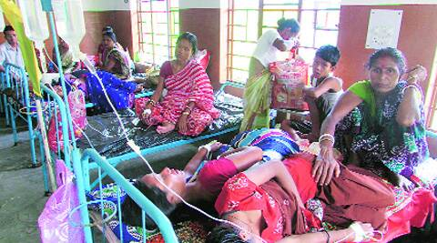 Patients admitted with fever at Dhupguri Hospital in West Bengal's Jalpaiguri on Tuesday.  Source: Express Photo