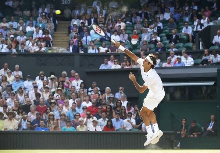 Chasing his eighth Wimbledon title, Roger Federer met Canada's Milos Raonic in the second semi-final on Friday. Federer got going from the start and greeted Raonic with some big serves. (Source: AP)