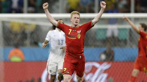 Belgium's Kevin De Bruyne celebrates as the match ends and Belgium defeated the USA 2-1 in extra time. ( Source: AP )
