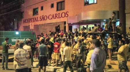 Fans gather outside the hospital where Neymar is being treated. (Source:  AP)