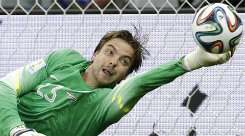 Netherlands' goalkeeper Tim Krul dives to saves the last penalty kick. (AP)