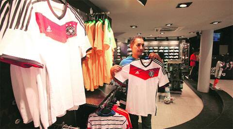 A football fan tries out a Germany jersey at the Sector 17 store on Saturday. ( Express photo by Kamleshwar Singh )