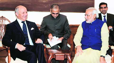 French Foreign Minister, Laurent Fabius with PM Narendra Modi at his residence in New Delhi, Tuesday.