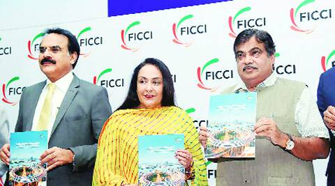 Union Minister for Transport and Shipping Nitin Gadkari with Finance Secretary Arvind Mayaram and Jyotsna Suri, Senior Vice-President, Ficci at the India PPP Summit 2014. PTI