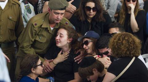 Relatives of Maj. Amotz Greenberg, 45, mourn during his funeral in the Israeli city of Hod Hasharon. (Source: AP)