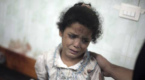 A Palestinian girl cries while receiving treatment for her injuries caused by an Israeli strike at a U.N. school in Jebaliya refugee camp, at the Kamal Adwan hospital in Beit Lahiya, northern Gaza Strip.Several Israeli tank shells slammed into the crowded U.N. school used as shelter for refugees in the Gaza war. (Source: AP)
