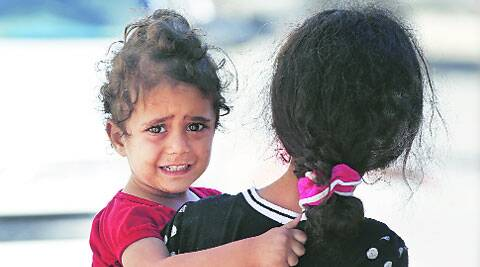 A girl cries as Palestinians flee their homes in the Shajaiyeh neighbourhood of Gaza City. (Source:	AP