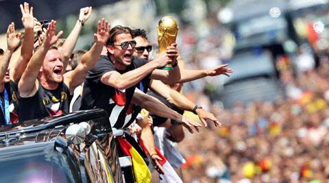 Germany players celebrate with the trophy (Source: AP)