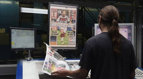 "A printer controls files of German newspaper ""Bild"" after Germany won the 2014 Brazil World Cup final (Source: Reuters)"