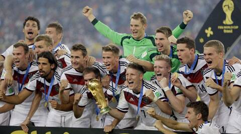 German players celebrate with the World Cup trophy following their 1-0 victory over Argentina (Source: AP)