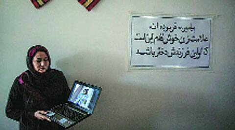 Dr Hassina Sarwari, the head of Women for Afghan Women, shows photos of the girl.