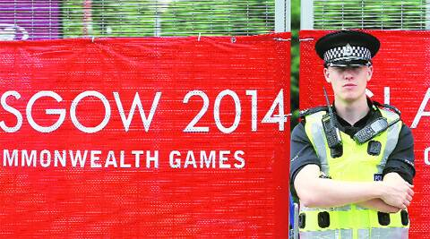 guard of honour: A police officer stands guard outside the Glasgow Commonwealth Games venue. Source; REUTERS