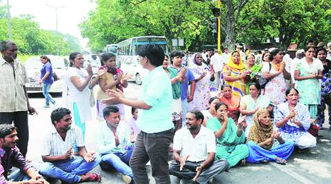 Family members and relatives of deceased block road in front of GMSH-16 on Saturday.
