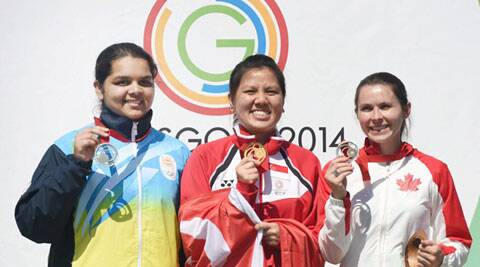 Silver medal winner India's Malaika Goel (L), Gold medalist Shun Xie Teo (C) of Singapore and Bronze medalist Dorothy Ludwig of Canada during the award ceremony of women's 10M Air Pistol event. (Source: PTI)