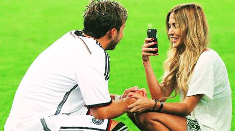 Mario Götze with his girlfriend Ann-Kathrin Brömmel after the win. Source: REUTERS