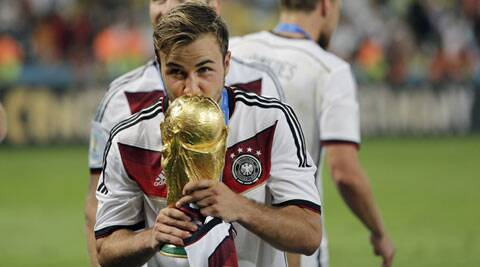 Germany's Mario Goetze kisses the trophy after winning the World Cup final against Argentina. (Source: AP)