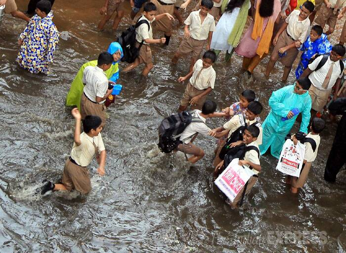 """There is a traffic jam due to water logging in suburban Dadar, Parel, Chembur and LBS Marg in Ghatkopar. The Andheri subway has been closed down completely due to water logging. We have been getting distress calls from citizens right from the morning,"" a senior Municipal Corporation of Greater Mumbai (MCGM) official said. (Source: Express photo by Ganesh Shirsekar)"
