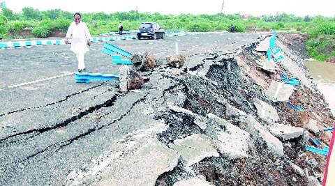 The perimeter of a newly inaugurated flyover that connects Manjalpur with Vadsar in Vadodara fell apart on Saturday.(Bhupendra Rana)