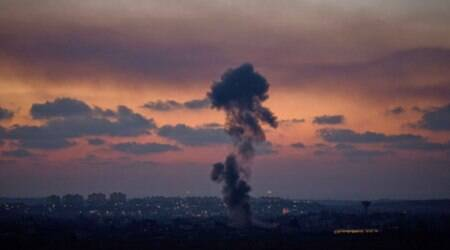 Smoke rises following an Israeli strike on Gaza, as seen from the Israel-Gaza Border. (Source: AP)