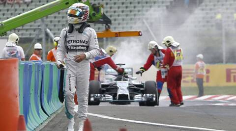 Hamilton walks off as the stewards douse the fire (Source: AP)