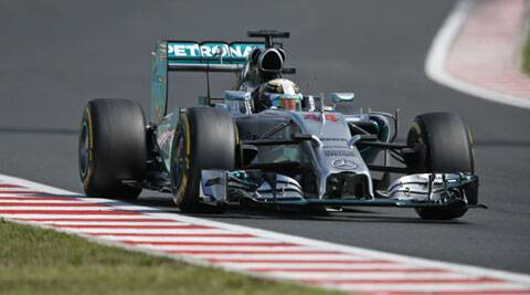 Lewis Hamilton steers his car during the free practice session at the Hungarian Formula One Grand Prix. (Source: AP)