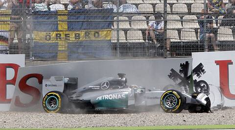 Lewis Hamilton crashes during the qualifying round of the German Formula One Grand Prix at Hockenheim on Saturday. (Source: AP)