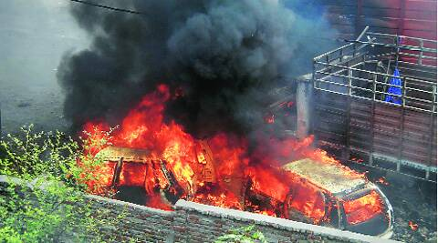 Vehicles set on fire by the mob in Hathras, UP, on Tuesday. Source: Gajendra Yadav