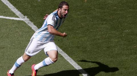 Argentina's Gonzalo Higuain celebrates after scoring a goal against Belgium (Source: Reuters)
