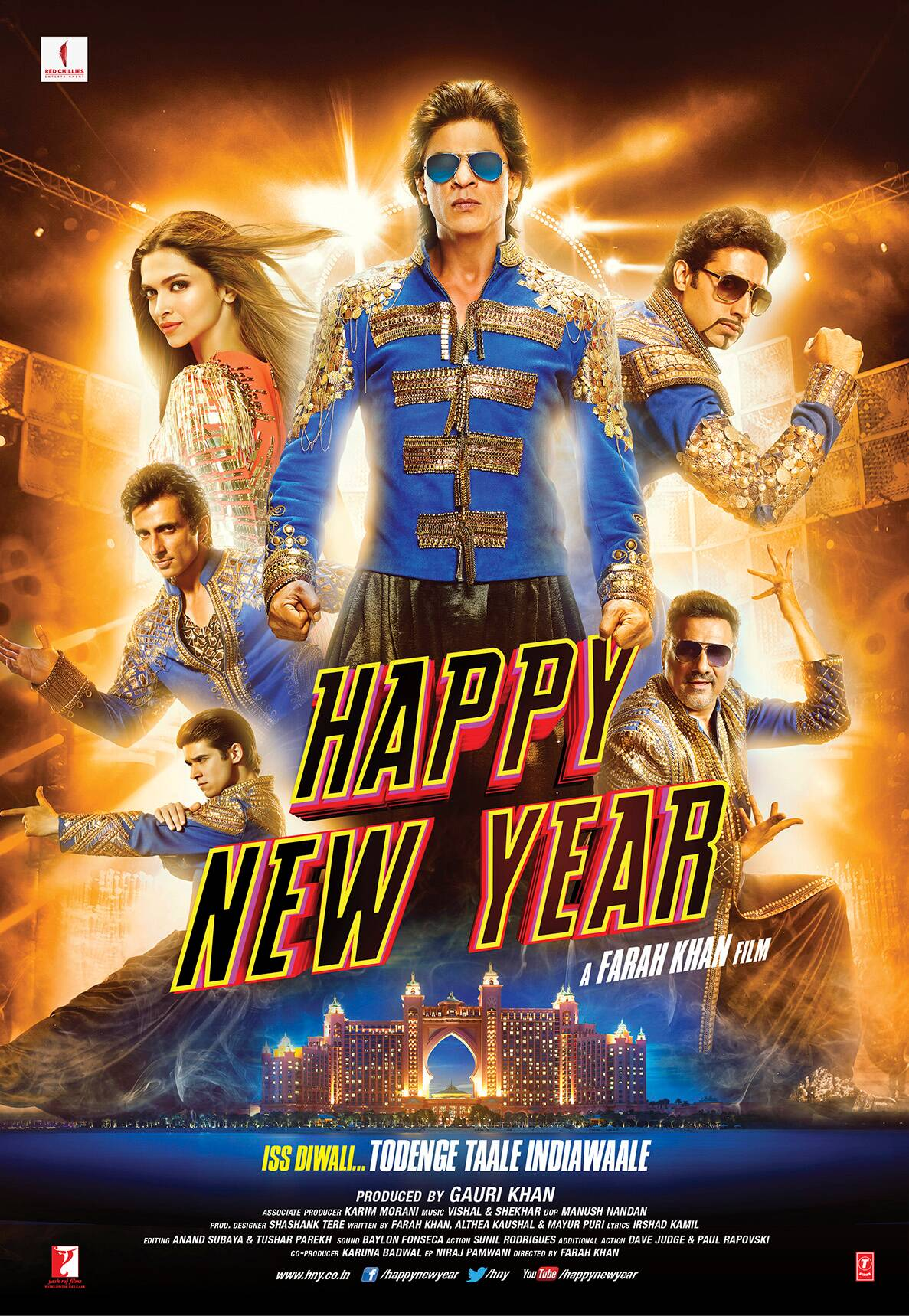 The new poster of Farah Khan's Happy New Year' is out with the film's cast dressed in suits of gold with blue. While the actors  - Shah Rukh Khan, Abhishek Bachchan, Sonu Sood, Boman Irani and Vivaan Shah look deadly, lead actress Deepika Padukone sizzles in a gold and orange outfit.