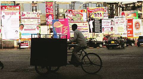 Over 1,050 illegal hoardings, banners and posters have been removed by the BMC in the past four months.( Express photo by Prashant Nadkar )