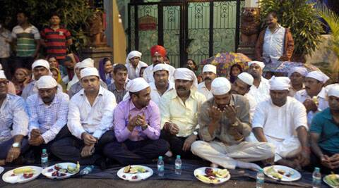 Protesters during iftar outside Shiv Sena leader Rajan Vichare's residence.