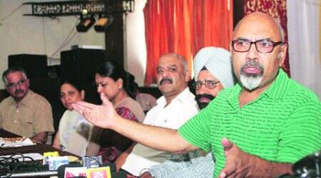 Former Punjab DGP (prisons) Shashikant (extreme right) with the affected parents, in Ludhiana on Thursday. (Express Photo: Gurmeet Singh)
