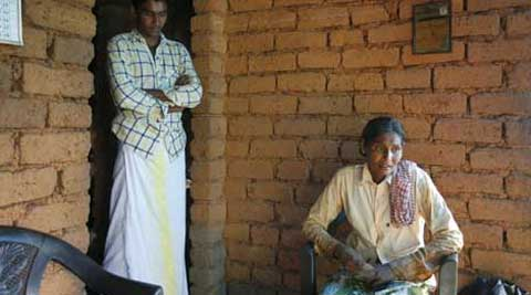 Indian nurse Teena's mother Lily and brother Tijo are both farm labourers. (Source: Express Photo)