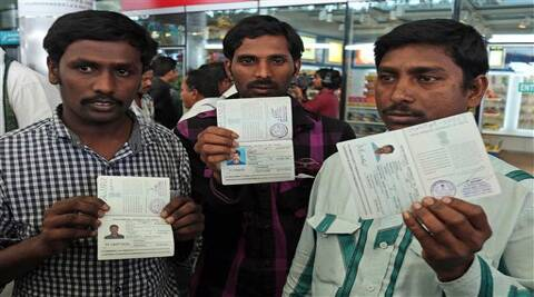 Indian workers from Iraq display their passports to the media upon arrival at the airport in Hyderabad. (Source: AP)