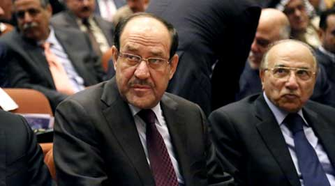 Iraqi Prime Minister Nouri al-Maliki, center, attends the first session of parliament in the heavily fortified Green Zone in Baghdad, Iraq. (Source: AP)